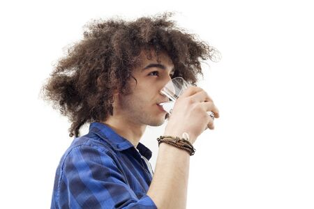man drinking water: Young man drinking water from glass