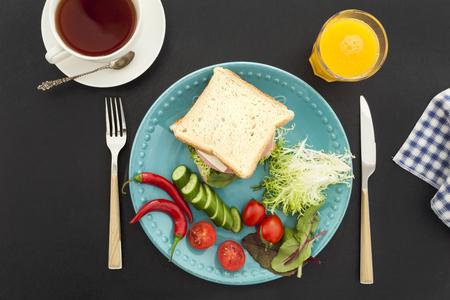 knife tomato: Breakfast on black background