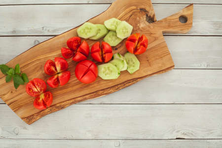 Sliced tomatoes on chopping board