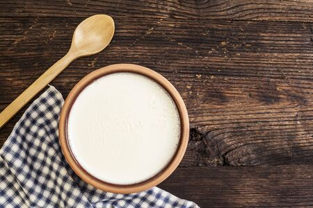 Homemade yogurt on wooden table
