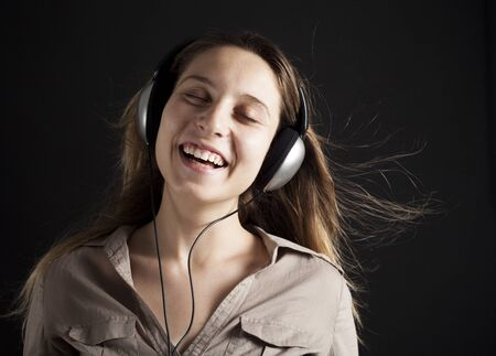 music listening: Young woman listening music Stock Photo