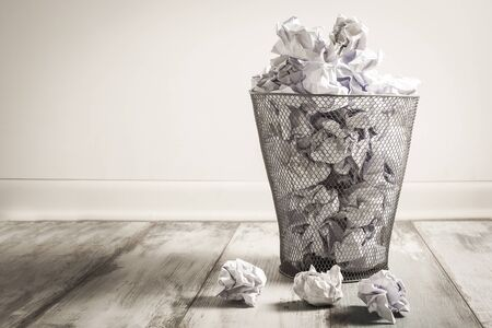 wastepaper: Crumpled paper in the trash can