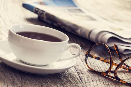 tea table: Newspaper with cup of coffee