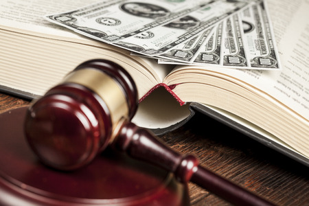 judicature: Justice gavel and money on the desk