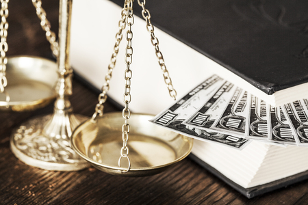 boodle: Justice scale and money on the desk