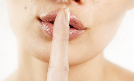 noiseless: Close up of a woman lips with finger