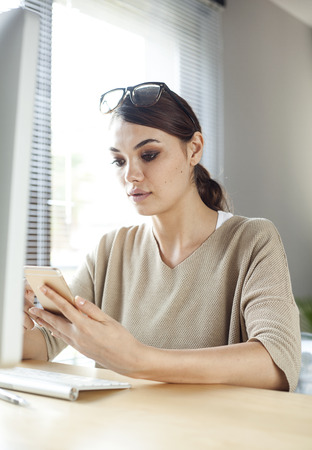 company person: Businesswoman using mobile phone