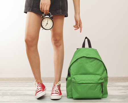 rucksack ': Student girl legs with backpack Stock Photo