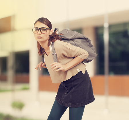 overweight students: Student girl  with heavy schoolbag Stock Photo