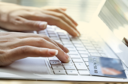 lady hand: Hands holding credit card and using laptop