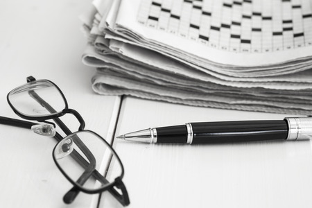 Crossword and pencil on wooden background Stock Photo