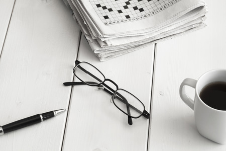 crosswords: Crossword and pencil on wooden background Stock Photo