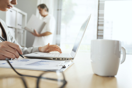 working desk: Businesspeople in the office Stock Photo