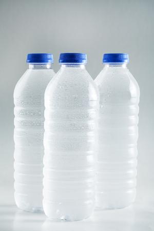 water bottles: Wet plastic water bottles isolated on white background