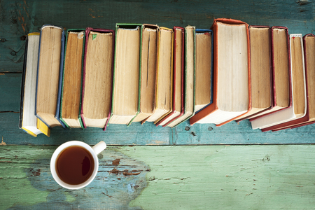 Reading book with coffee on table