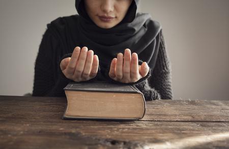 koran: Muslim woman reading holy islamic book koran Stock Photo