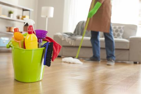 Man holding mop and plastic bucket Foto de archivo