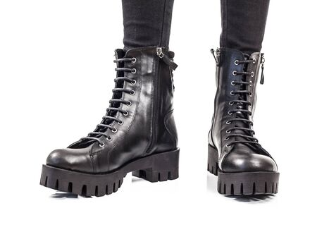 women in boots: Black leather boots isolated on white background