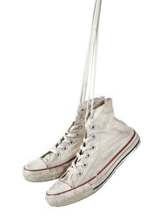 canvas background: Old white sneakers on white background