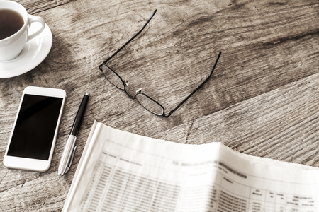broadsheet: Newspaper on wooden table