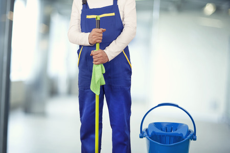 workforce: Man with cleaning supplies in building