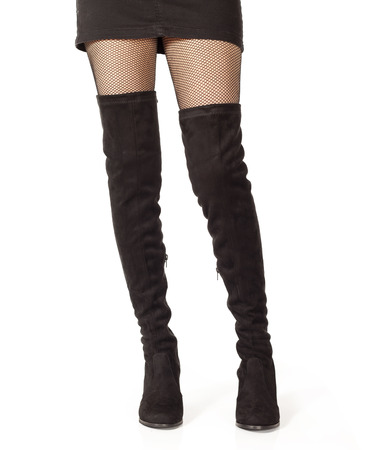 knee boots: Woman legs in black suede boots on white background