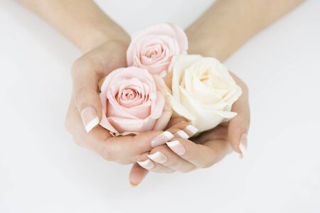 cosmetics background: Pink roses in woman hands