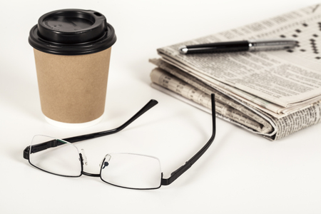 broadsheet: Coffee with newspaper on white background Stock Photo