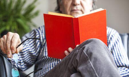 old books: Senior man reading book
