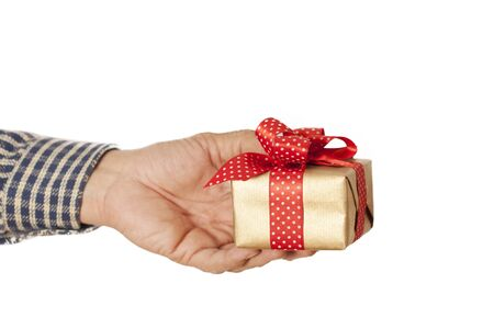 receiving: Man hand gives gift in box Stock Photo