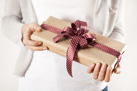 Woman hands holding gift box