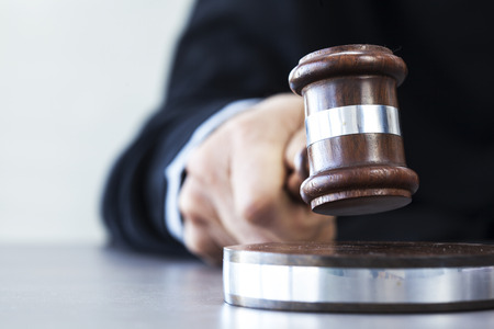legally: Judge with gavel on table Stock Photo