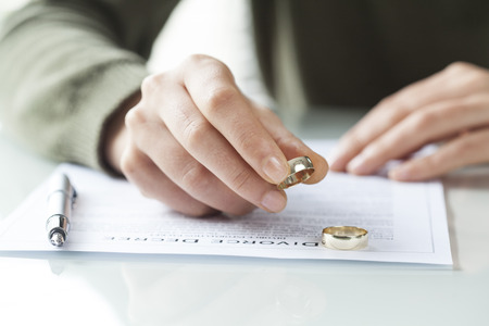 adultery: Woman taking off wedding ring Stock Photo
