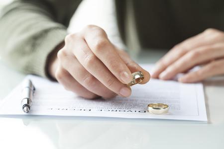 Woman taking off wedding ring Stock Photo