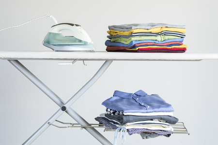 Ironing clothes on ironing board