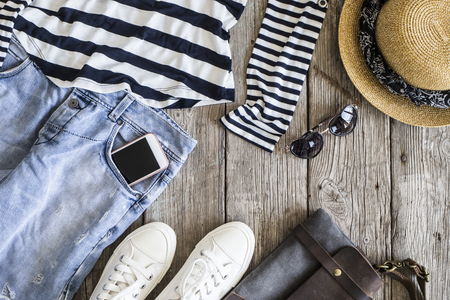Fashionable women clothes on wooden background Stock Photo