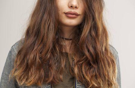 long hairs: Woman wavy hair close up view