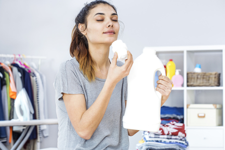 smells: Young woman smells of detergent
