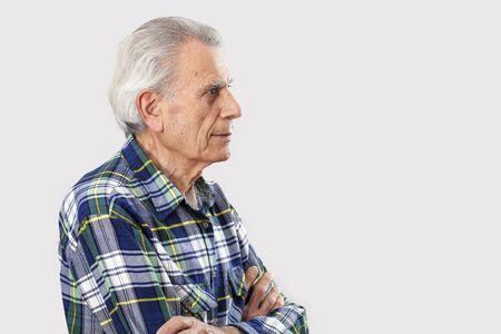 Portrait elderly man on gray background Stock Photo