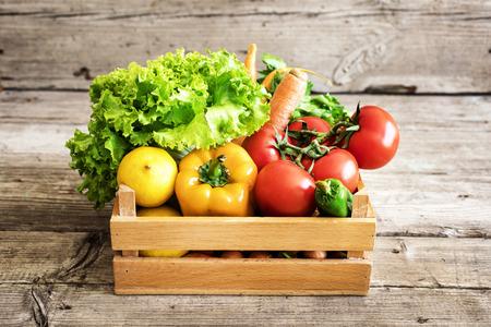 Vegetables in basket on wooden table