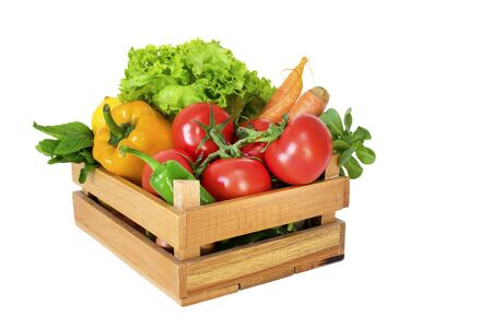 Vegetables in basket on white background