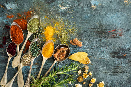 dafne: Spices and herbs on wooden background Archivio Fotografico