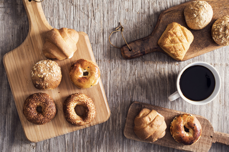 bollos: Hot coffee and pastries on a wooden background
