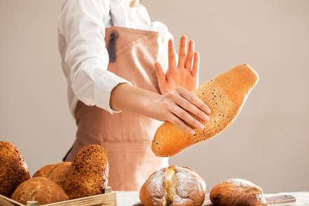 Woman refusing to eat white bread