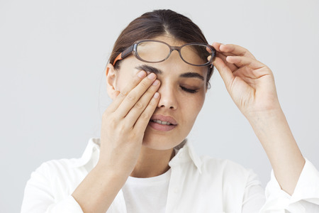 Young woman with eye fatigue