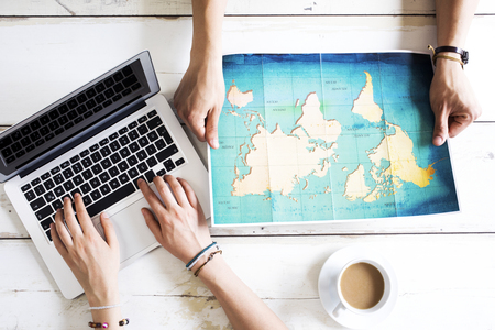 Travel planning on computer Stock Photo