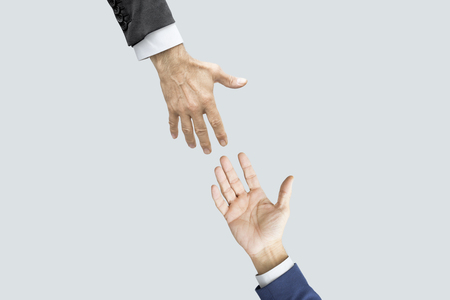 Hands reaching each other