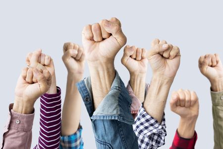 Group of fists raised in air