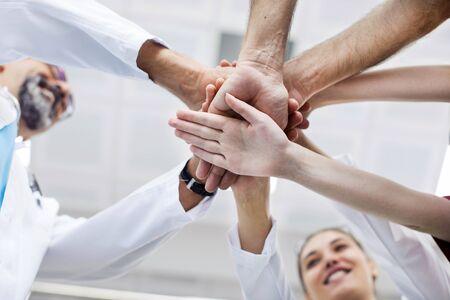 Medical team stacking hands