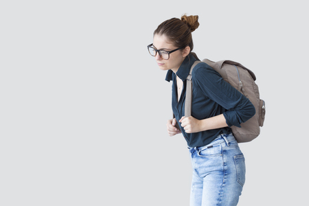 Student girl with heavy schoolbag 스톡 콘텐츠